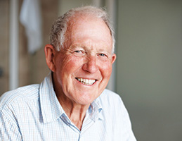 Photo of a man smiling. Link to Life Stage Gift Planner Over Age 65 Situations.