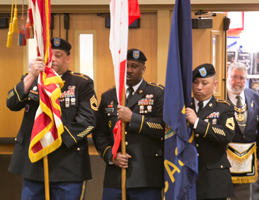 Photo of presentation of the flags. Link to What to Give.